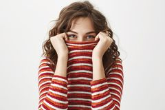 Free I See You. Studio Shot Of Emotive Joyful Woman In Trendy Striped Sweater Hiding Face In It And Glancing Through Collar Royalty Free Stock Image - 112346266