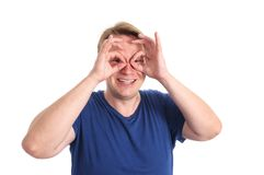 I see you. Young man doing the owl for eyes/glasses related concepts - isolated on white and retouched Royalty Free Stock Images