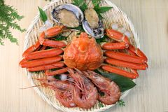 Marine products helping of various kinds of dishes. I served an abalone, a deep red snow crab, red prawns to a colander Royalty Free Stock Photos