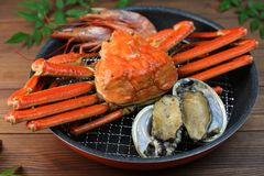 Marine products helping of various kinds of dishes. I served an abalone, a deep red snow crab, red prawns to a colander Royalty Free Stock Image