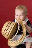 I shall eat this hat!. The small child in studio, on a red background Royalty Free Stock Photography