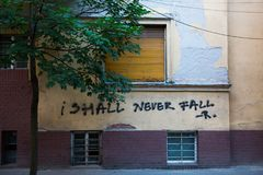 I shall never fall. Grafitty on wall Stock Images