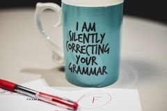 `I am silently correcting your grammar` coffee mug royalty free stock photography