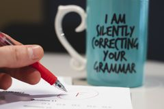`I am silently correcting your grammar` coffee mug stock image