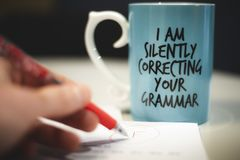 `I am silently correcting your grammar` coffee mug stock photography