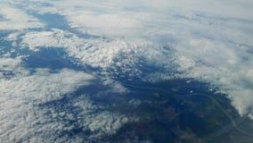 I skyen Sikt på jord royaltyfria foton