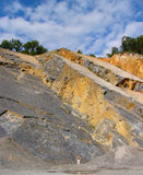 I am so small. Figure looking small in out-of-use quarry in belgium Royalty Free Stock Images