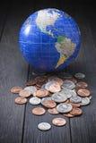 I soldi coniano l'affare globale immagine stock