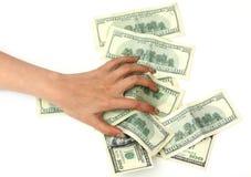 I soldi a disposizione isolati sopra Fotografie Stock Libere da Diritti