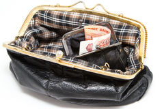 I soldi sono nel portafoglio, la borsa nera delle donne Immagini Stock Libere da Diritti