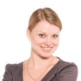 I sorrisi della ragazza isolati sul bianco Fotografia Stock