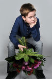 I am sorry. Boy waiting with a bunch of flowers to say i am sorry stock image