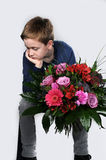 I am sorry. Boy waiting with a bunch of flowers to say I am sorry stock images