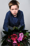 I am sorry. Boy waiting with a bunch of flowers to say  I am sorry Stock Photos