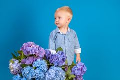 I am sorry. Childrens day. Small baby boy. Summer. Mothers or womens day. New life concept. Spring holiday. Little boy. At blooming flower. Spring flowers royalty free stock image