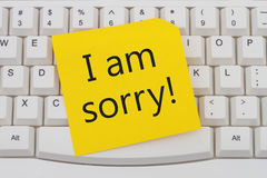 I am sorry. A close-up of a keyboard with yellow sticky note with text I am Sorry Royalty Free Stock Images
