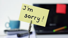 I am sorry at the office. I am sorry written on a memo in a office Royalty Free Stock Photos
