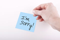 I am Sorry Phrase Note Paper. Hand typing I am Sorry Note Stock Photography