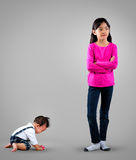 I'am sorry. Sad little boy with sister stock photo