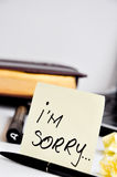 I am sorry sticky note post card. I'm sorry sticky note post card on an office table Royalty Free Stock Images