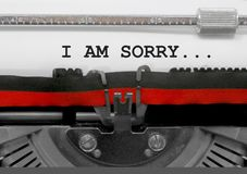 I AM SORRY text by the old typewriter on white paper. I AM SORRY. text written by an old typewriter on white sheet royalty free stock photography