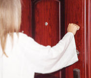 I stand at the door and knock. Behold, I stand at the door and knock. If anyone hears my voice and opens the door, then I will come in to him, and will dine with royalty free stock photography