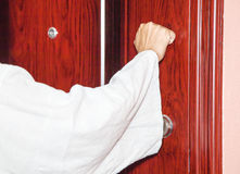 I stand at the door and knock Stock Photo