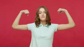 I am strong and independent! Self-confident successful young woman in polo t-shi. Rt showing biceps looking proudly at camera feeling power and energy. indoor stock video footage