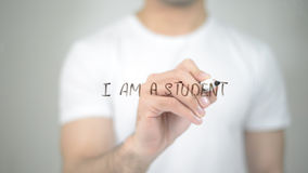 I am a Student, man writing on transparent screen royalty free stock photo