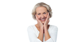 I am really surprised about the news. Cheerful old woman with surprised expression Royalty Free Stock Image