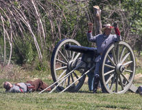 I Surrender. Red Bluff, California, United States-April 25, 2015: A Confederate gunner surrenders  during a Civil War reenactment at Fog Island Stock Photos