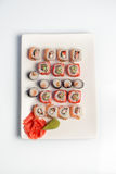 I sushi placcano su priorità bassa bianca Immagini Stock