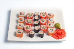I sushi placcano su priorità bassa bianca Fotografie Stock Libere da Diritti