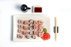 I sushi placcano su priorità bassa bianca Fotografia Stock Libera da Diritti
