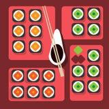 I sushi presentano su stile piano del fondo di colore Fotografia Stock