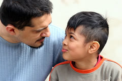 I tell you a story. A young father talking to his son Stock Photography