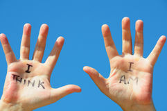 I think I am. Hands with the words I think, I am written on them stock image