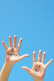 I think I am. Hands with the words I think, I am written on them royalty free stock images