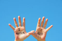 I think I am. Hands with the words I think, I am written on them stock photos