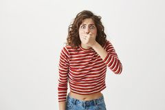 I think I am going to blew up. Portrait of young woman covering mouth and bending towards camera with worried and sick. Expression, wanting to clear stomach Stock Image