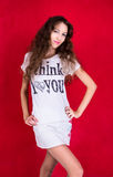 I think I love you. Pretty girl in shirt with inscription on the red background Stock Images