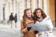 I think we should go there. Two beautiful young women holding a stock photography