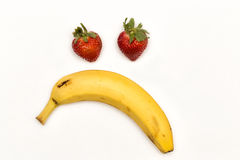 I am Thinking. Strawberries and banana forming a pensive face Royalty Free Stock Photo