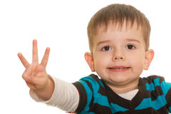 I am three!. A closeup portrait of a cheerful little boy showing his three fingers; isolated on the white background royalty free stock photo
