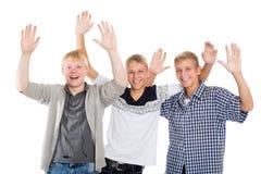 I tipi allegri con le loro mani si sono alzati nel saluto Immagini Stock Libere da Diritti