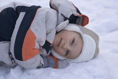 I am tired. Tired boy on snow royalty free stock photo