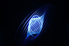 Light painting, blue spiral royalty free stock photos