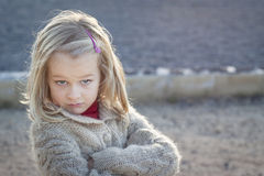 I told you so attitude. A small girl with crossed arms and a cheeky attitude stock photos