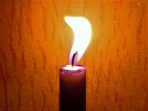 I toni caldi dalla candela Fotografia Stock