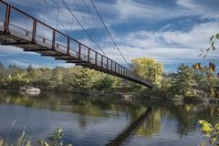 A summer on a bridge. I took this photo in Maine, it is called the Historic Bridge in Brunswick, the masterpiece stands strong. It was during fall, it had not Stock Photos